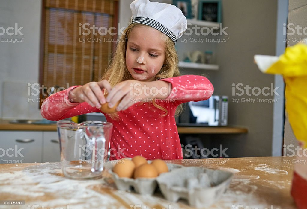 Baking up something delicious in the kitchen stock photo
