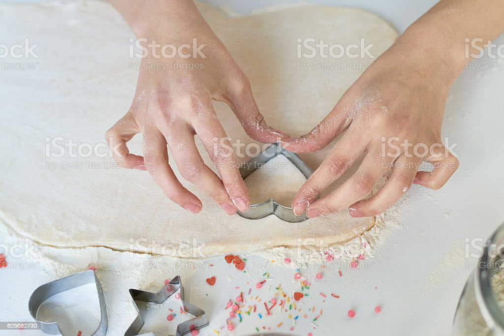 Baking Valentine cookies stock photo
