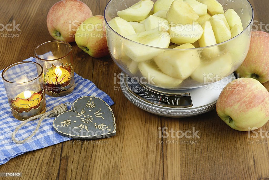 baking. Weigh the apple on scales. royalty-free stock photo