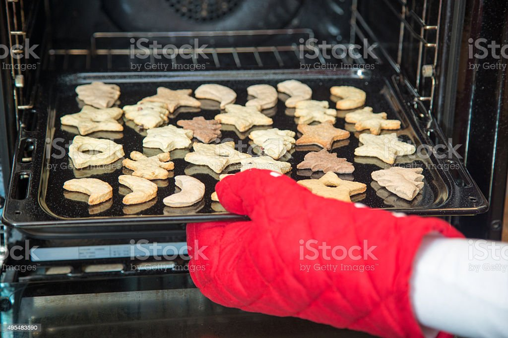 Baking winter holiday cookies. stock photo