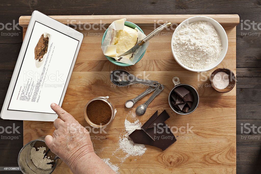 Baking With A Digital Tablet stock photo