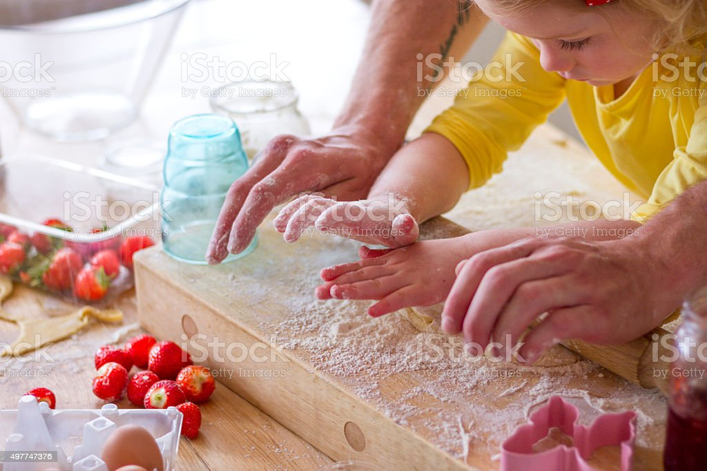 Baking with Daddy stock photo