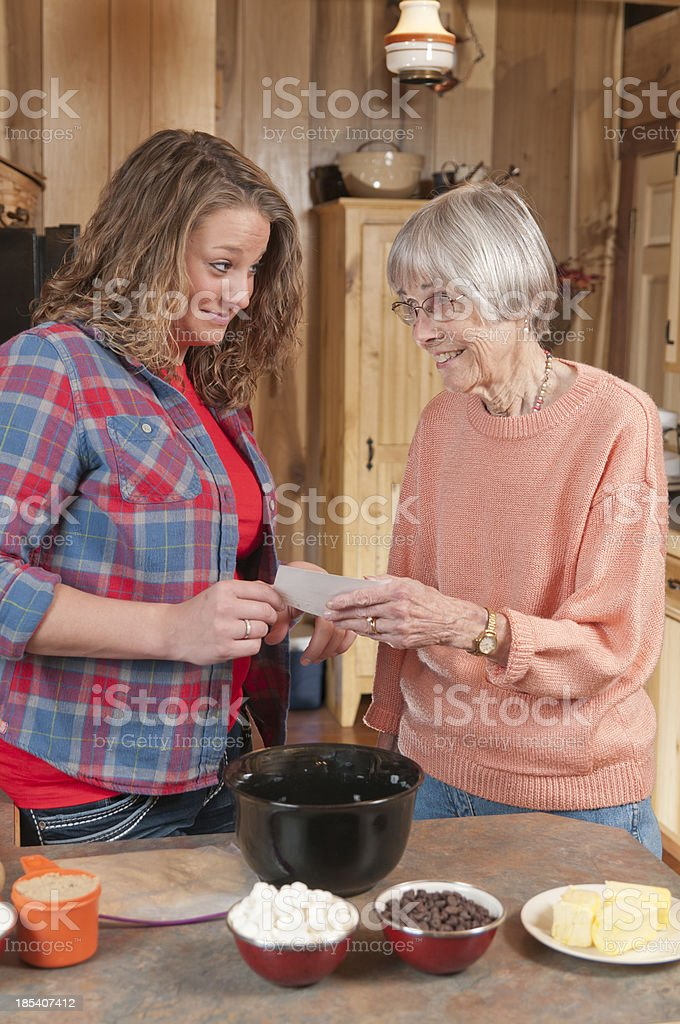 Baking with Grandma and her  Secret Recipe royalty-free stock photo