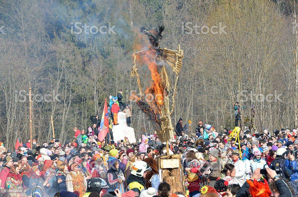 Bakshevskaya Shrovetide. The burning of straw effigy of Maslenitsa stock photo