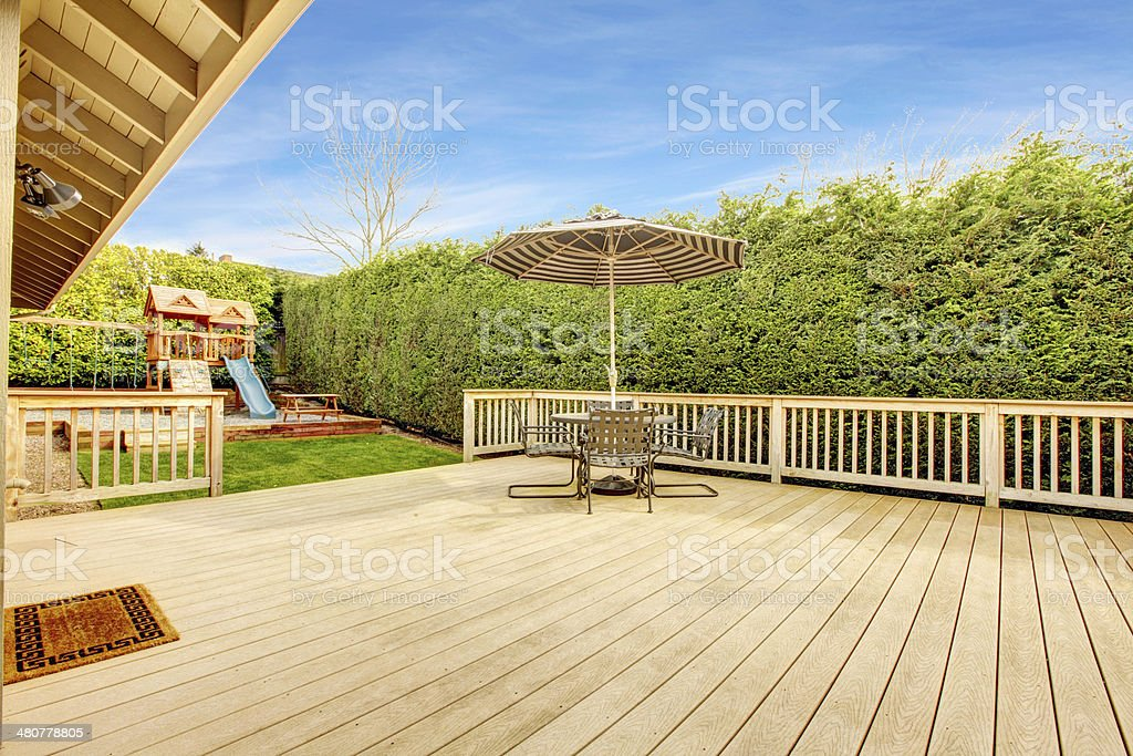Bakyard with patio area and play yard for kids stock photo