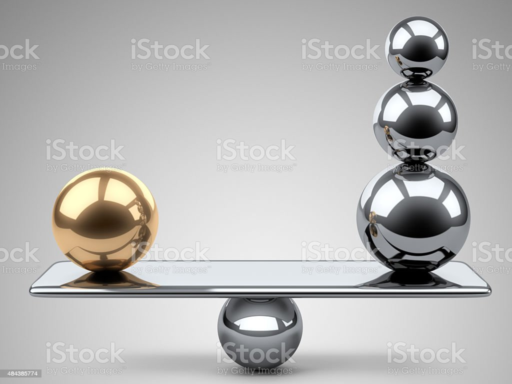 Balance between large gold and steel spheres. stock photo