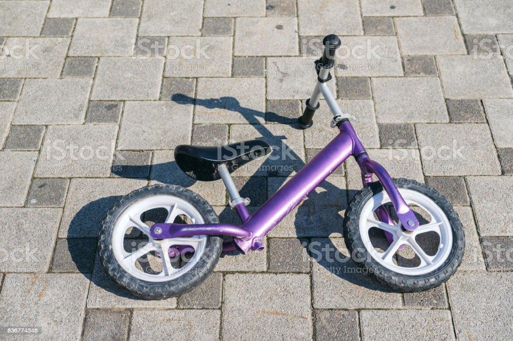 balance bike on asphalt background toned stock photo