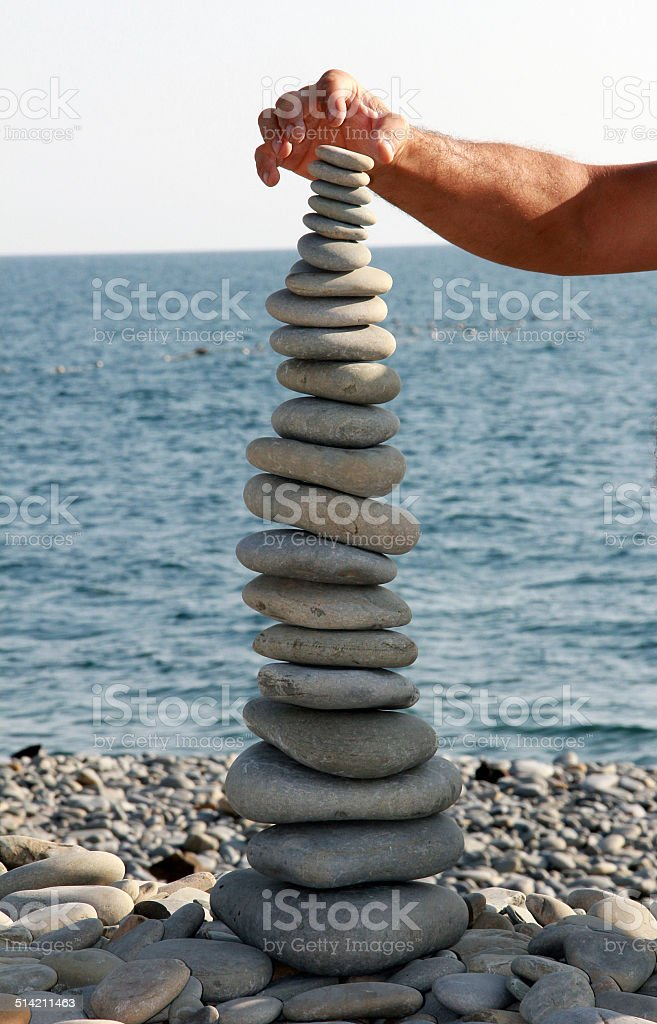 Balance in the tower of the sea stones stock photo