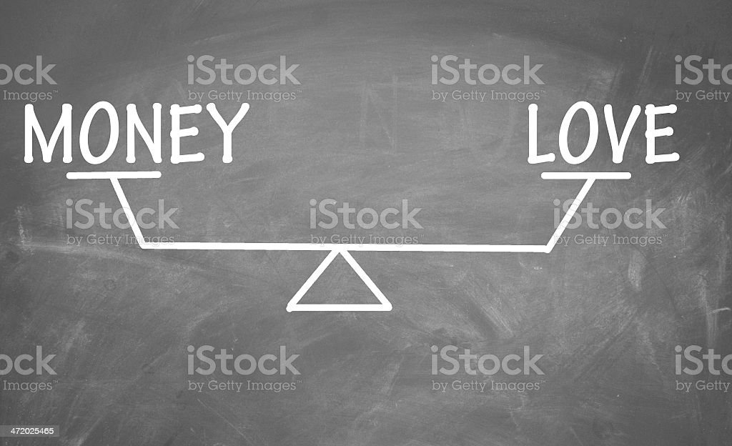 Balance of money and love stock photo