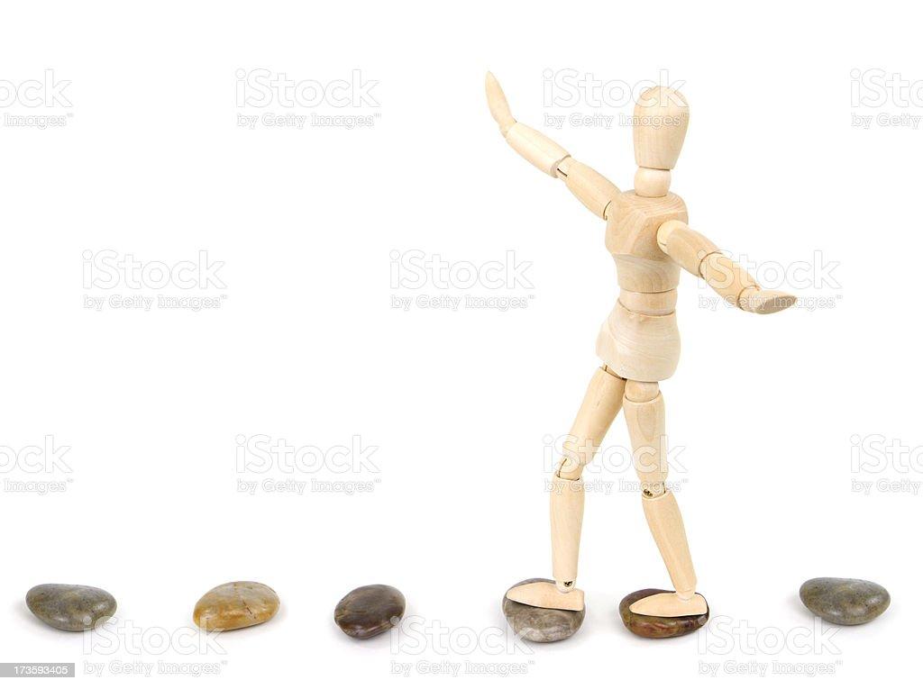 Balance on Stepping Stones royalty-free stock photo