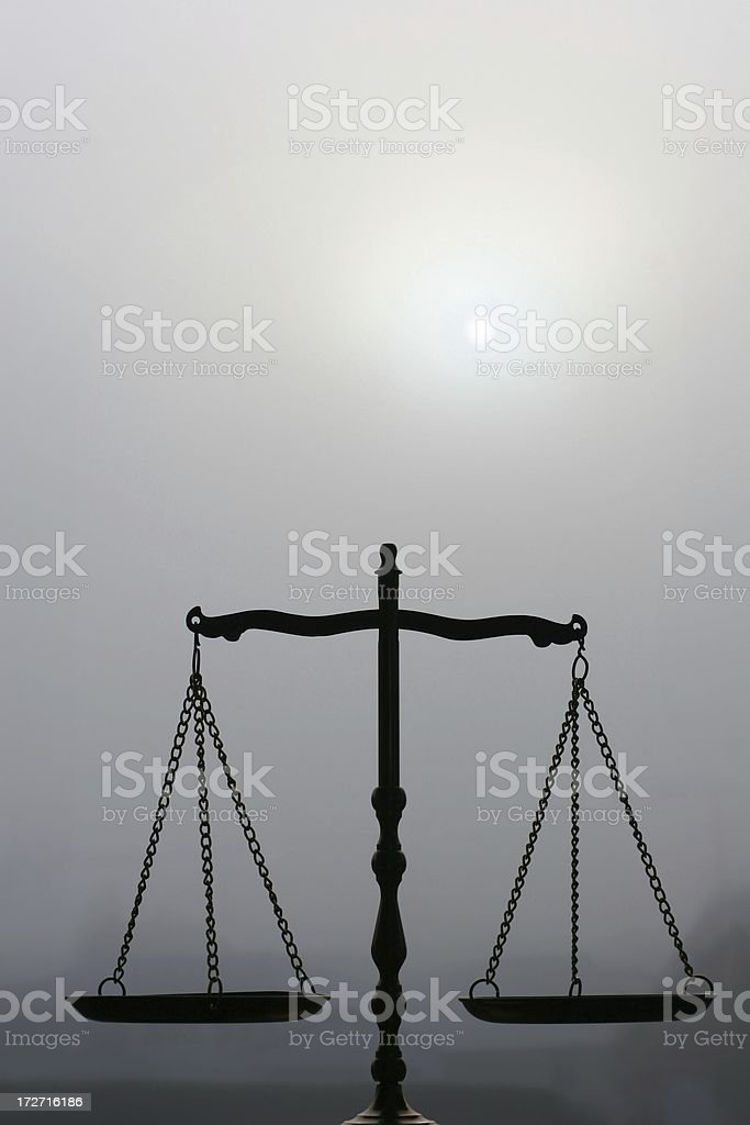 Balance Scale In The Fog stock photo