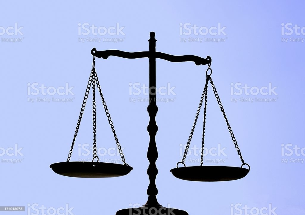 Balance Scale On Blue Background royalty-free stock photo
