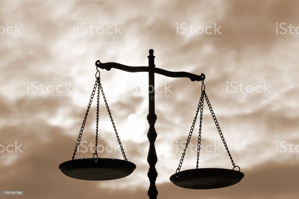Balance Scale On Sepia Background royalty-free stock photo
