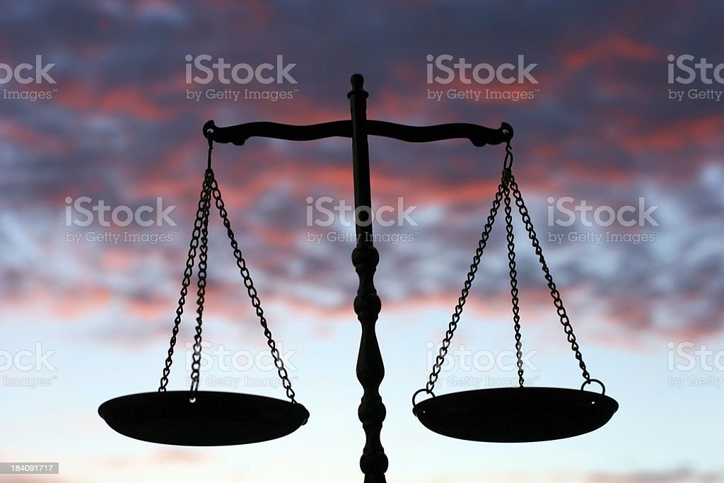 Balance Scales Against Evening Sky royalty-free stock photo