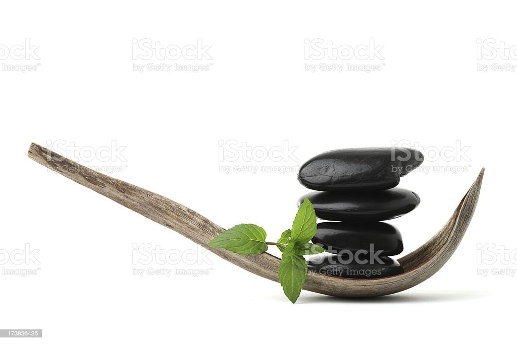 Balance Stones in Coconut Shells with Mint royalty-free stock photo