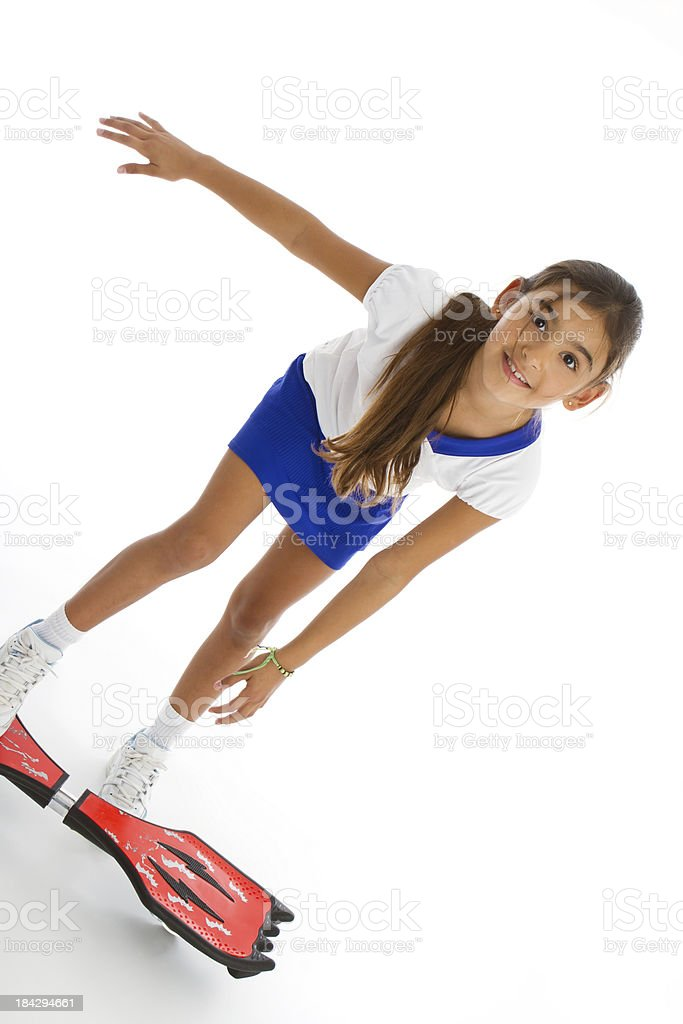 Balanced little skateboarder stock photo