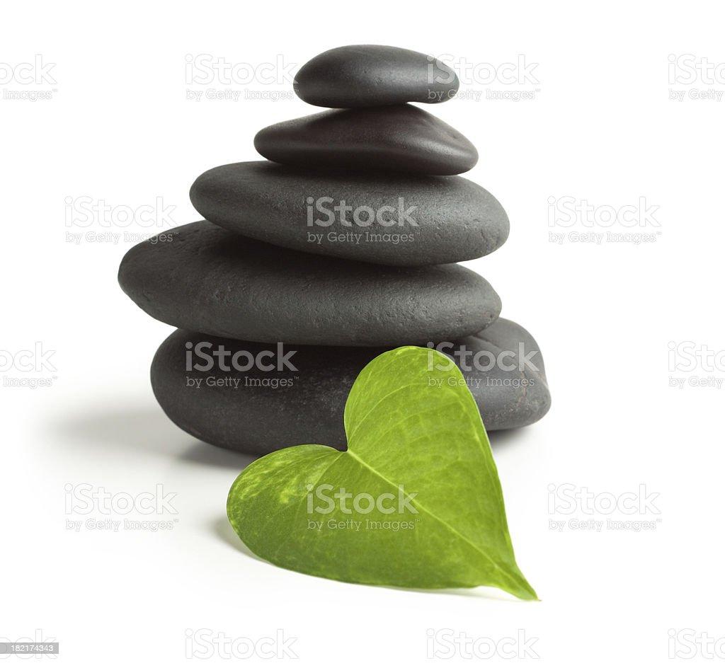 Balanced massage stones and heart stock photo