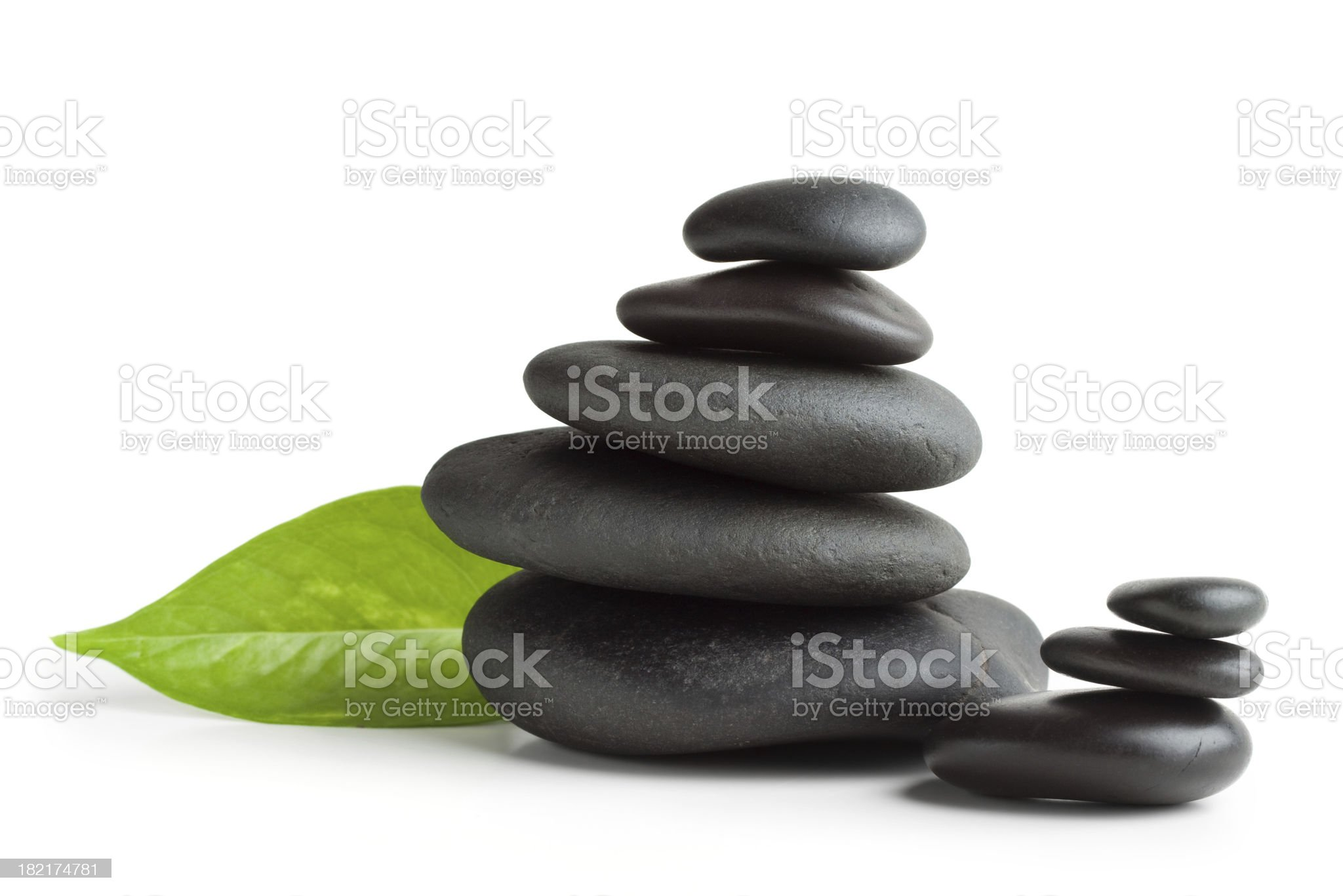Balanced massage stones, isolated royalty-free stock photo