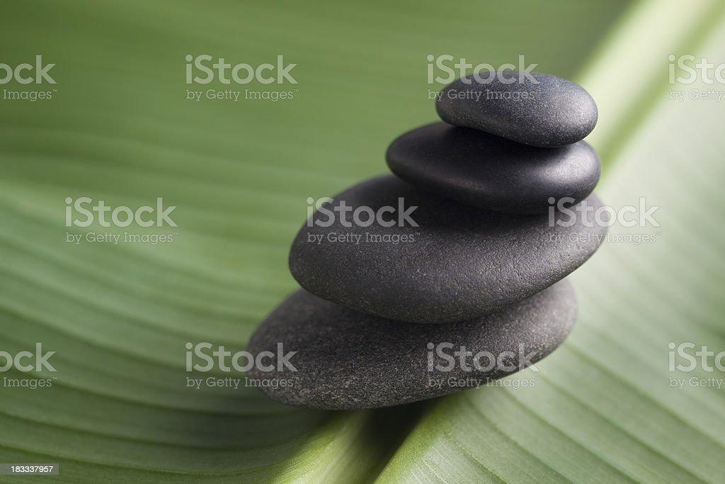 Balanced massage stones on leaf royalty-free stock photo