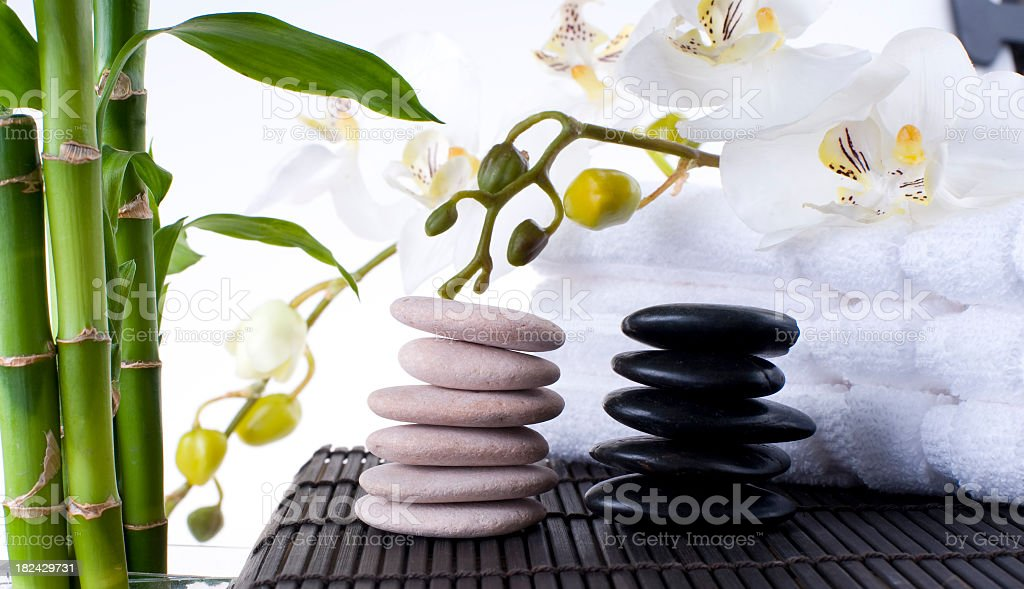 Balanced Massage Stones on Mat with towels stock photo
