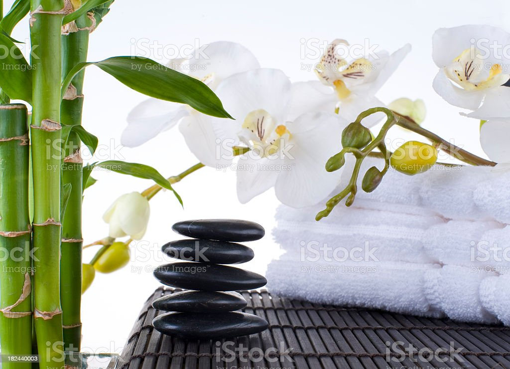 Balanced Massage Stones on Mat with towels royalty-free stock photo