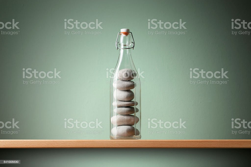 Balanced pebbles in the bottle. Concept image. stock photo