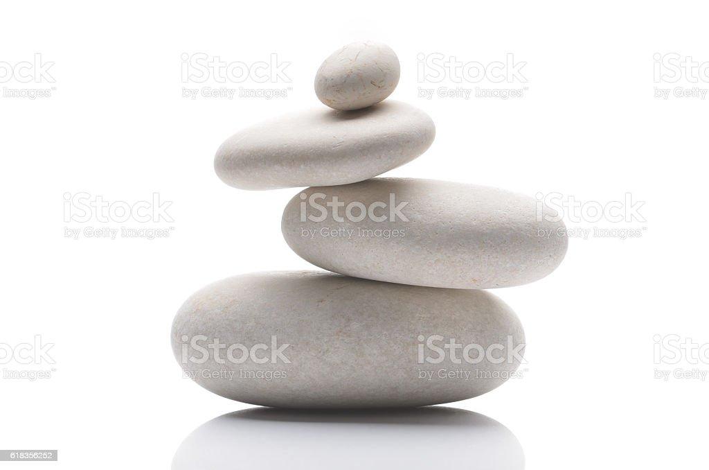 Balanced pebbles, isolated on white background with reflection stock photo