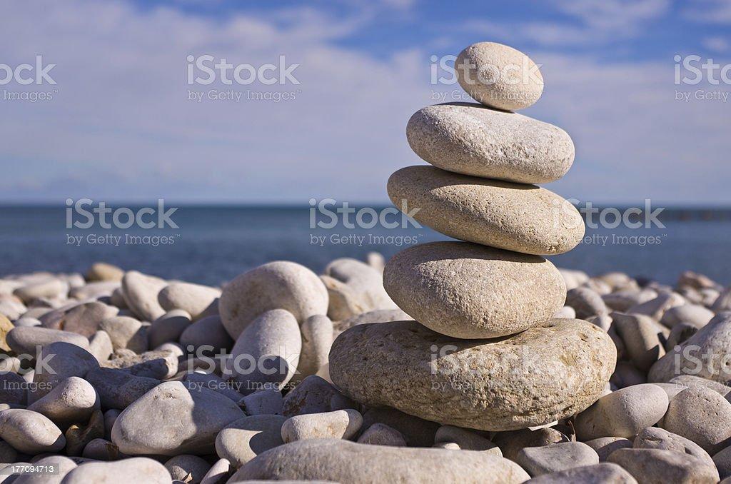 Balanced Pebbles On Beach royalty-free stock photo