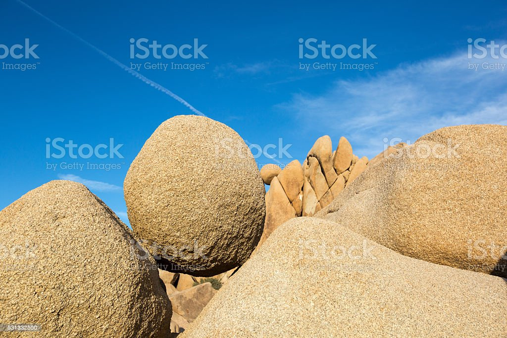 balanced round rock in joshua tree national park stock photo