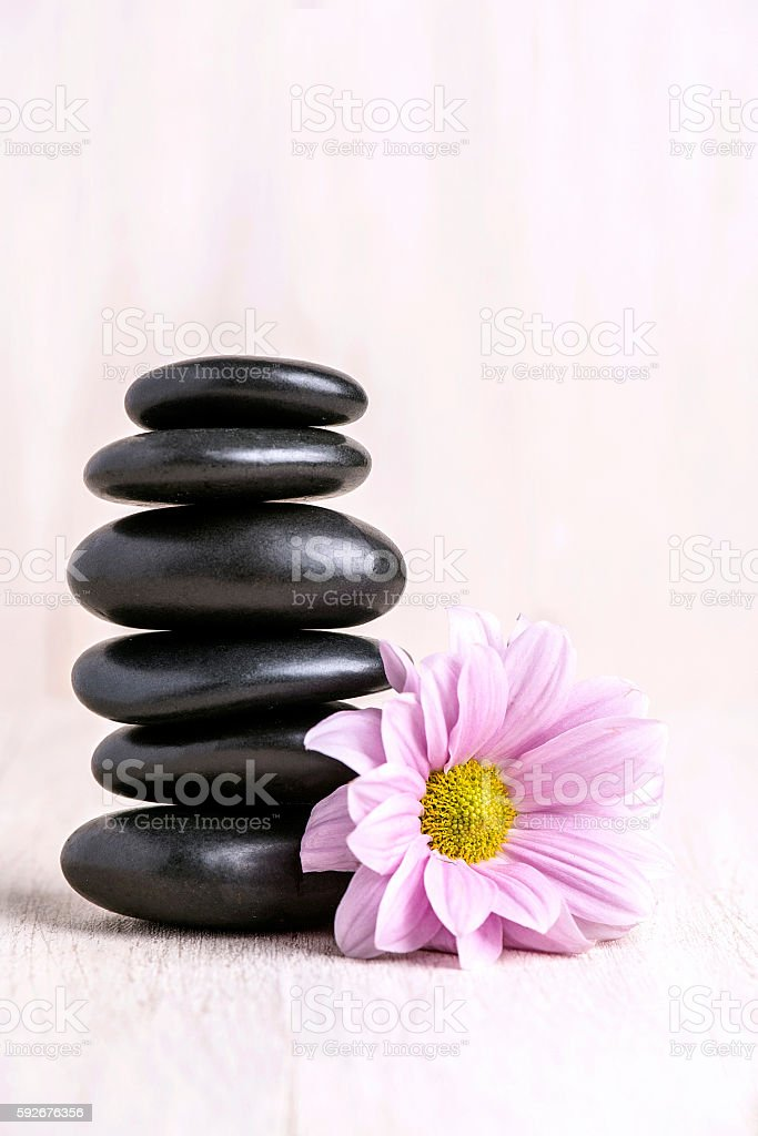 Balanced Stack with Flowers of Zen Pebbles stock photo
