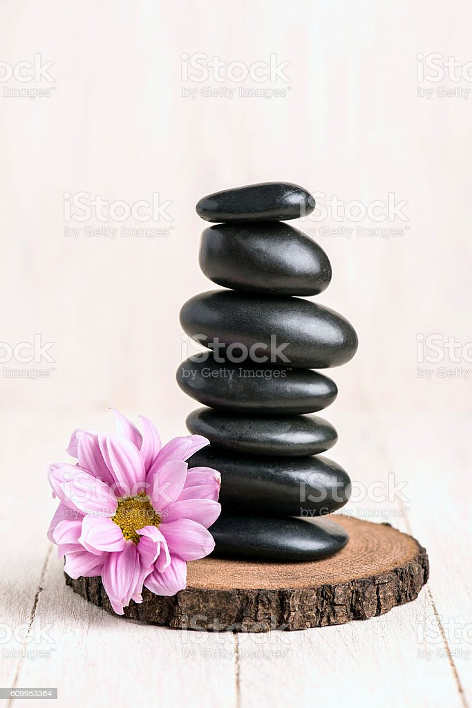 Balanced Stack with Pink Flowers of Zen Pebbles stock photo