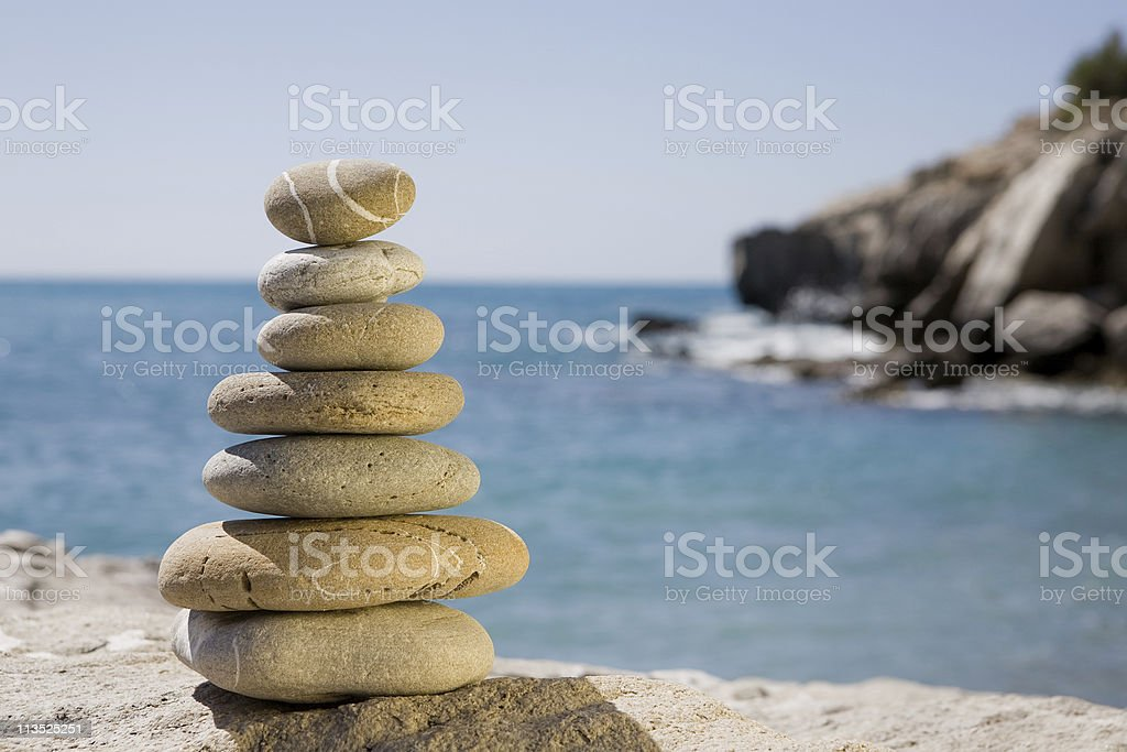 Balanced stones by the sea royalty-free stock photo