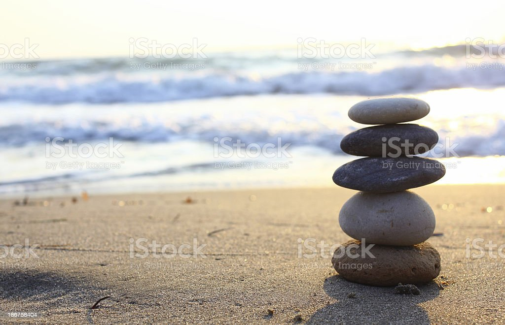 Balanced stones on beach stock photo
