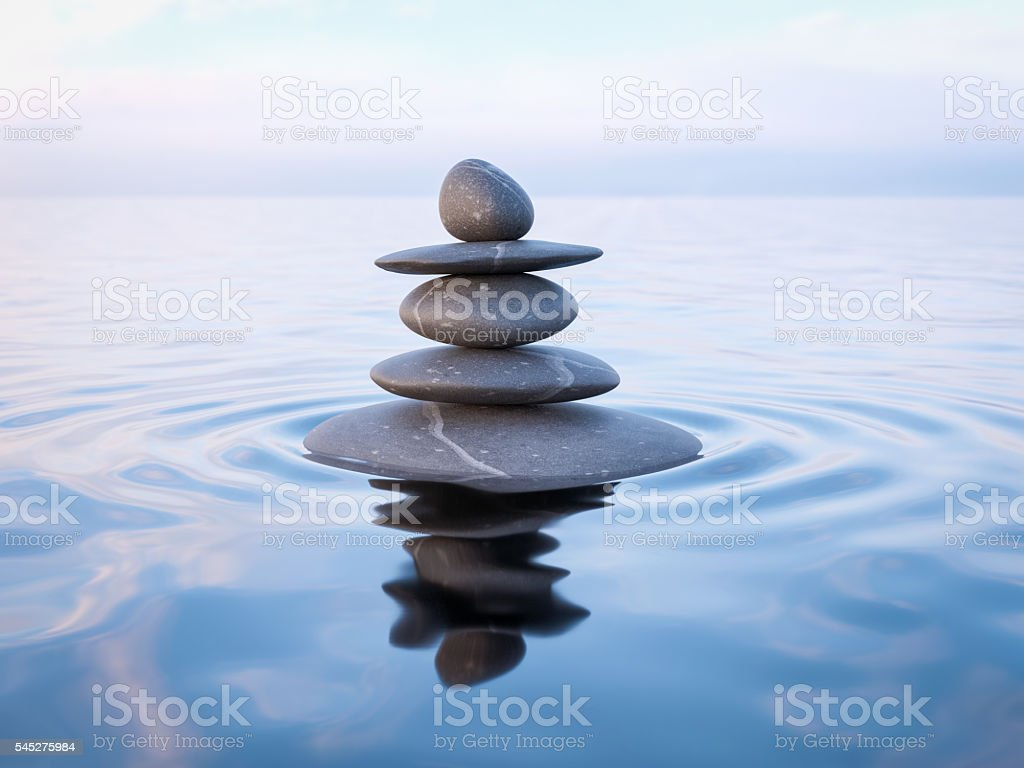 Balanced Zen stones in water stock photo