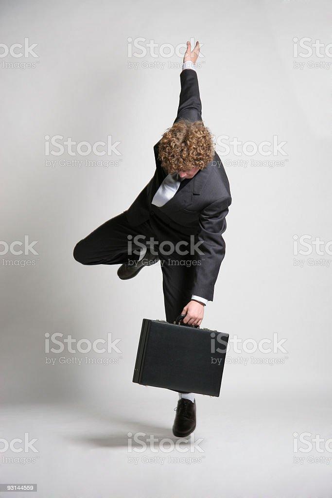 Balancing act for businessman royalty-free stock photo