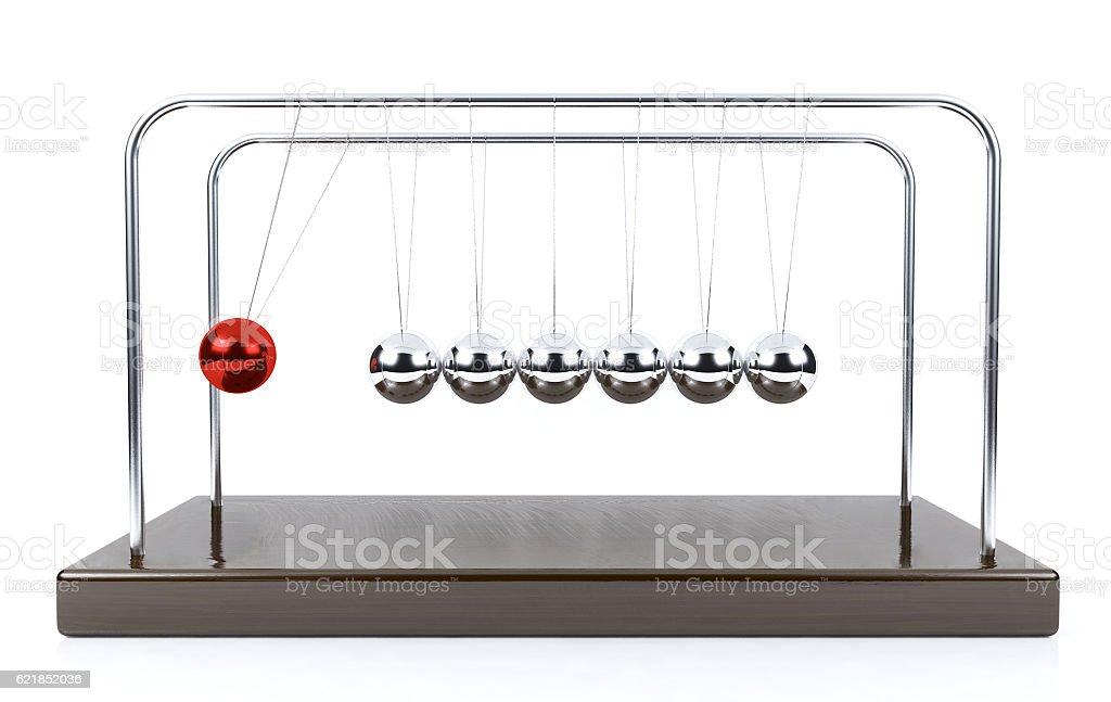 Balancing ball Newton's cradle pendulum isolated on white background stock photo