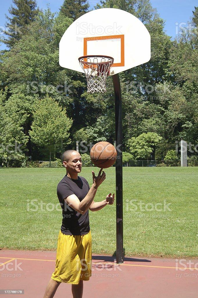 Balancing Basketball royalty-free stock photo