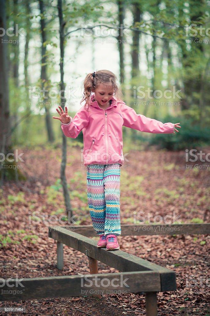 balancing blond girl stock photo