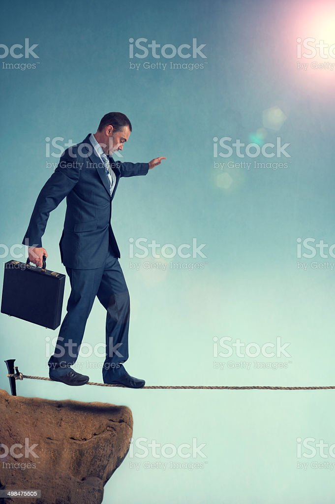 balancing businessman stock photo