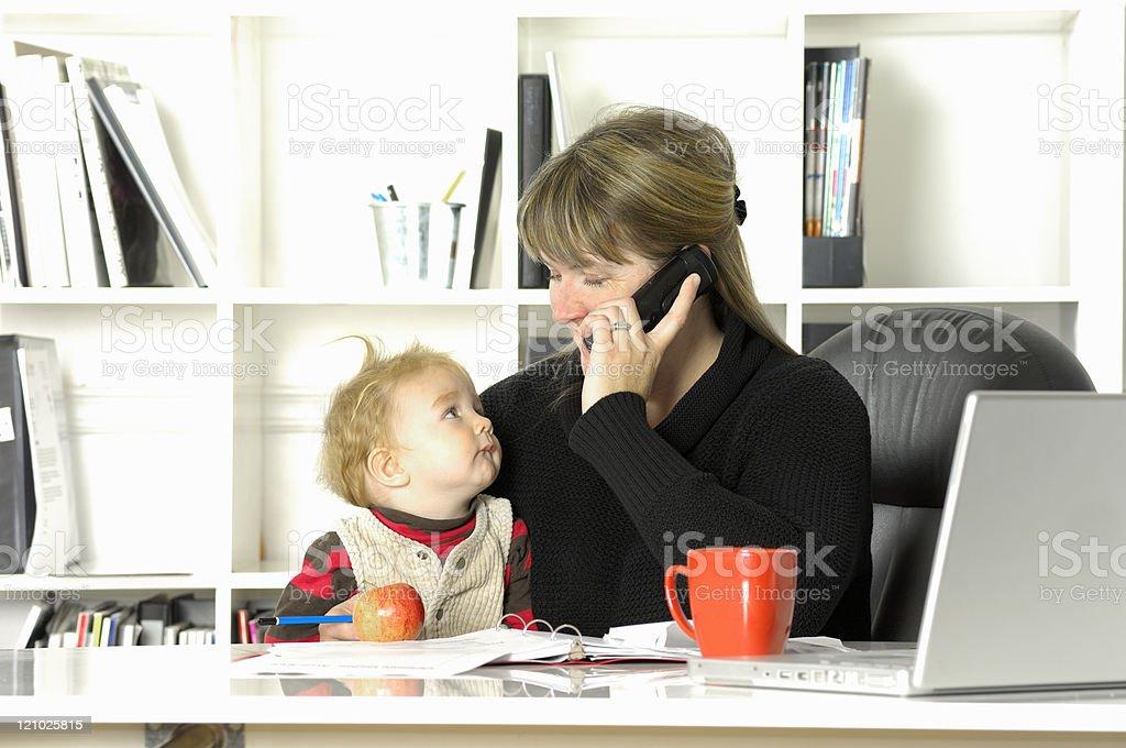 Balancing children and work stock photo