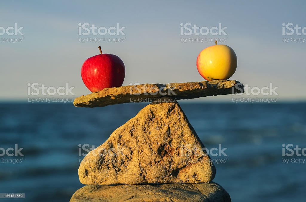 Balancing of apples stock photo