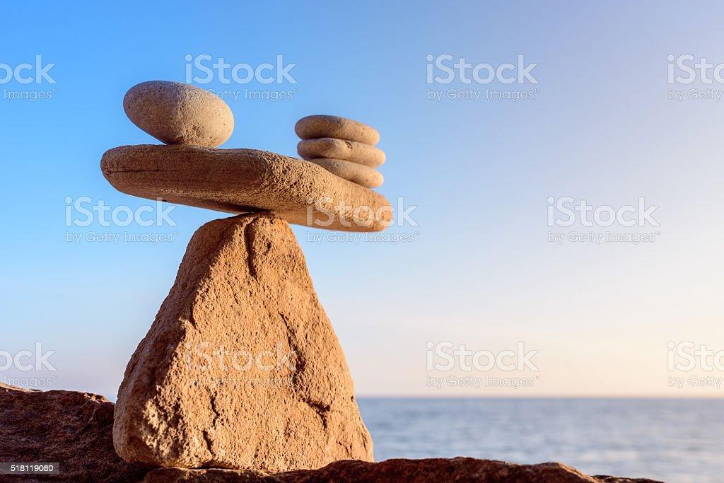 Balancing of pebbles stock photo