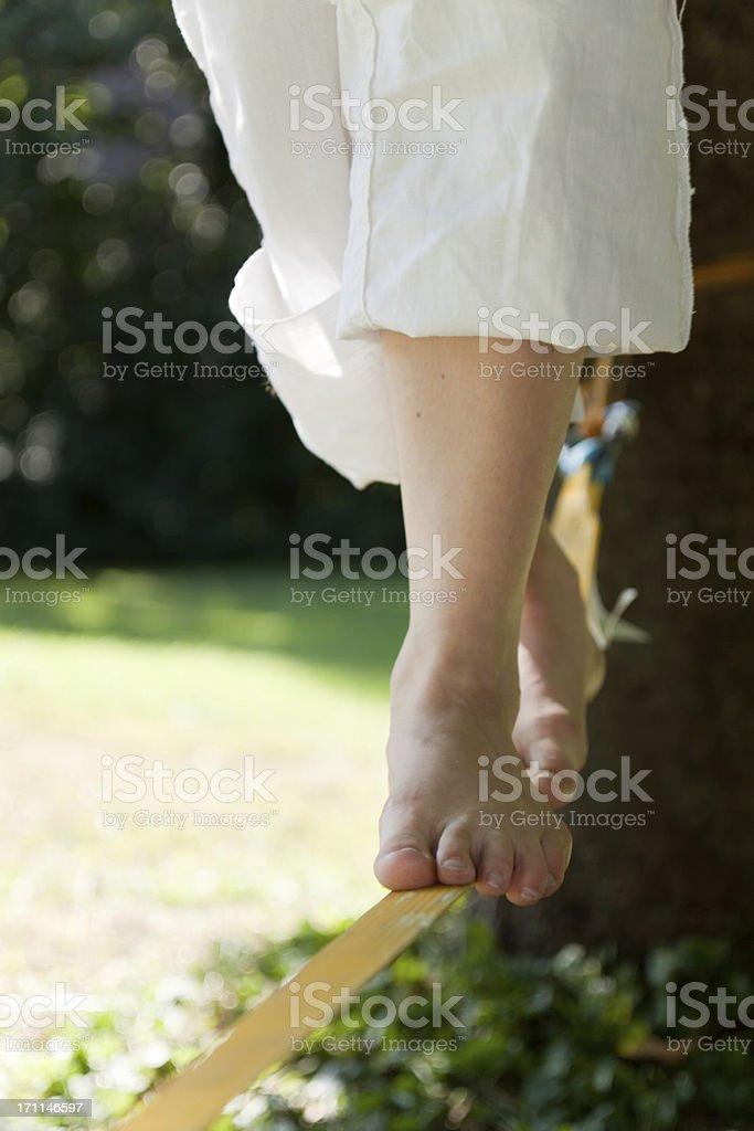 Balancing on a Slackline royalty-free stock photo
