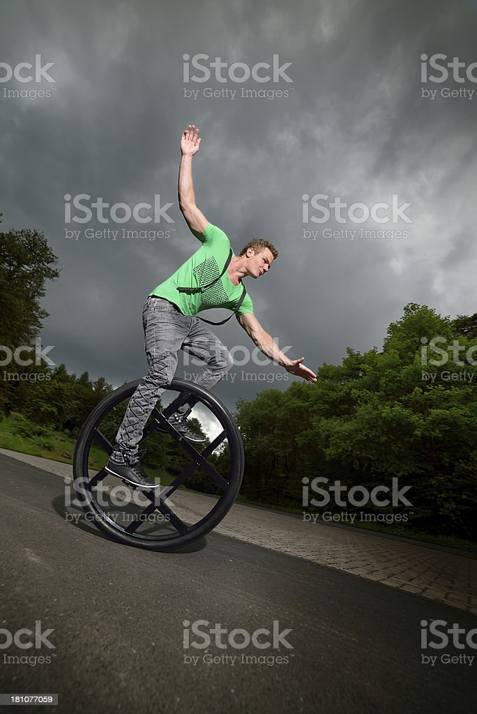 balancing on a unicycle stock photo
