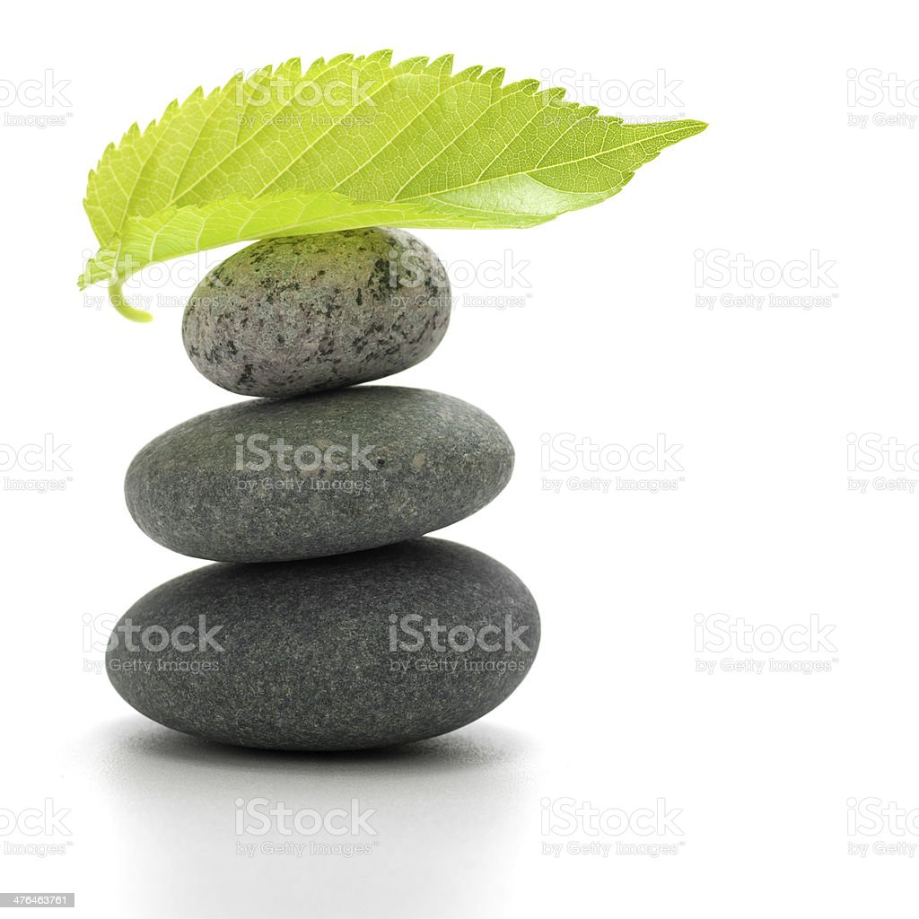 balancing pebbles stock photo