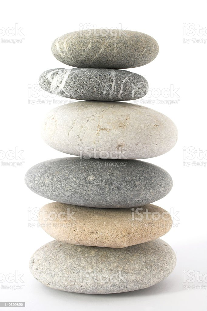A balancing stack of pebbles on top of each other stock photo