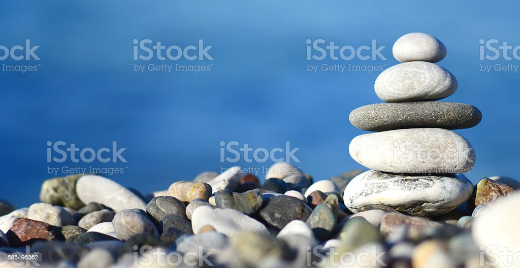 balancing stone tower stock photo