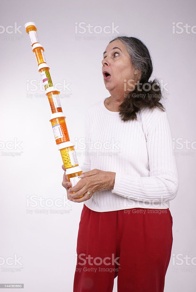 Balancing Tall Stack of Pill Bottles royalty-free stock photo