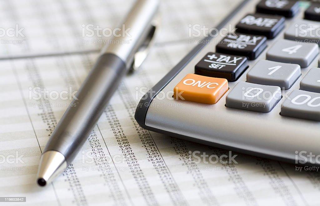 Balancing the Accounts. Calculator, pen royalty-free stock photo