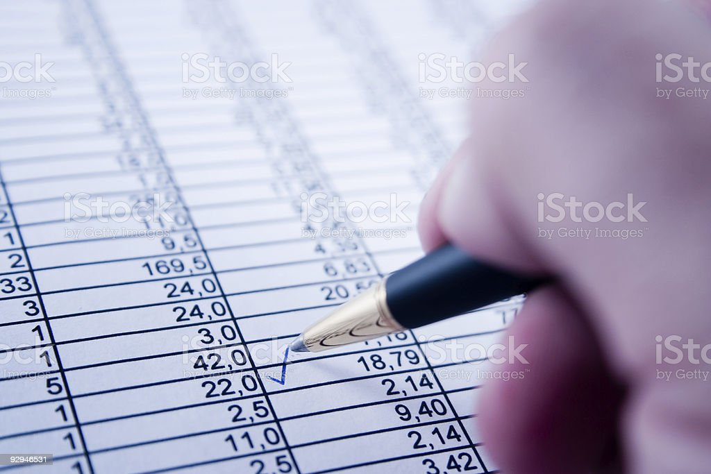 Balancing the accounts on paper with numbers royalty-free stock photo